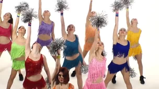 Cheerleading, girls dancing smiling at the camera. emotions. slow motion