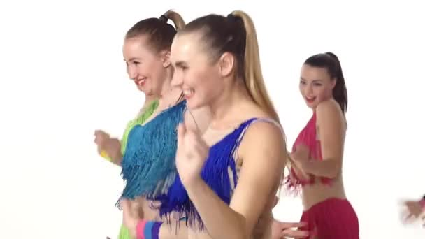 girls dancing smiling at the camera. slow motion. Close up. emotions