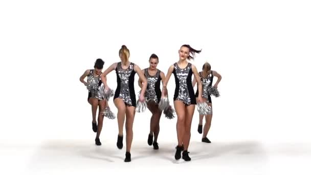 Beautiful dancing girls: cheerleading, pom-poms in hand, smile, slow motion