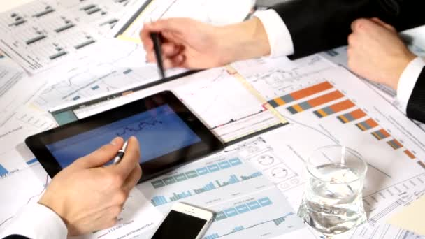 Business negotiations: a tablet with graphs on the table, developing a business project and analyzing market data information
