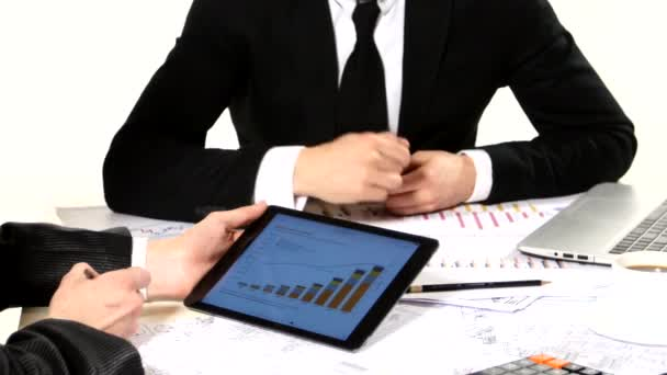 Businessman showing each other graphics on the tablet, developing a business project and analyzing market data information