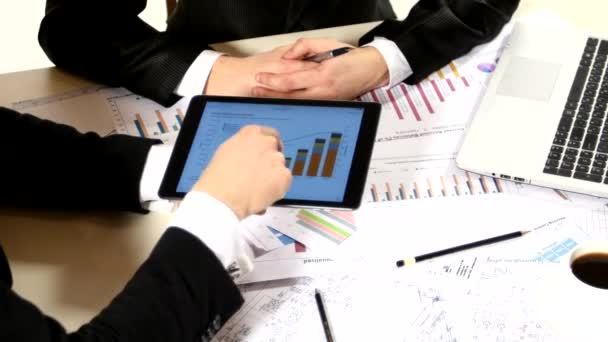 Businessmen consider drawing on the tablet and contract, developing a business project and analyzing market data information