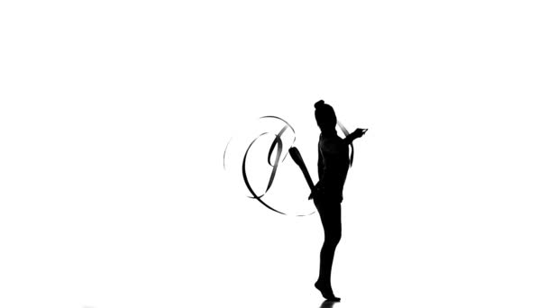 Silhouettes Gymnastic stunt with ribbon, slow motion