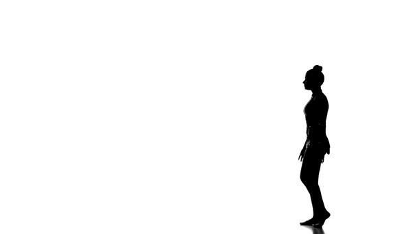 Young girl doing gymnastics , isolated over white