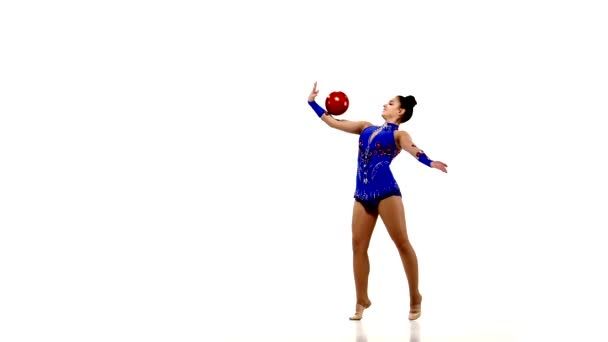 Active young girl gymnast with acrobatics ball