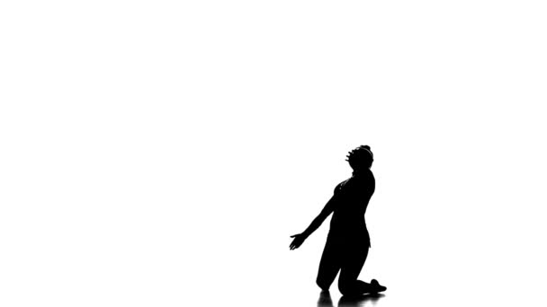 Silhouettes Gymnast plays with a ball, nice trick, white and black picture,slow motion