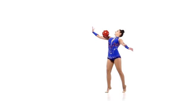 Active young girl gymnast with acrobatics ball, slow motion
