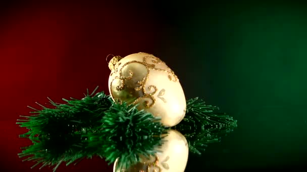 Gold toy for Christmas or New Year, rotation, on red and green