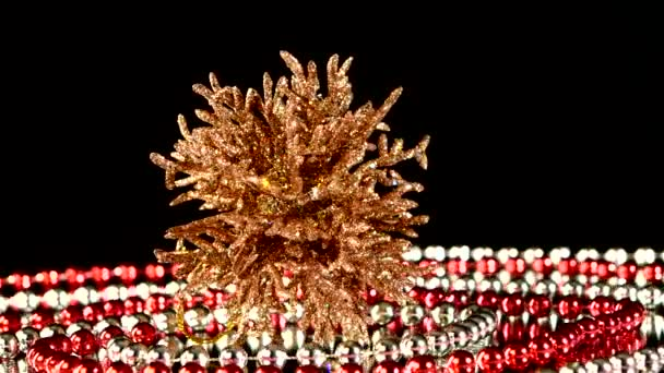 Unusual coral toy for Christmas or New Year and beads, rotation, reflection, on black