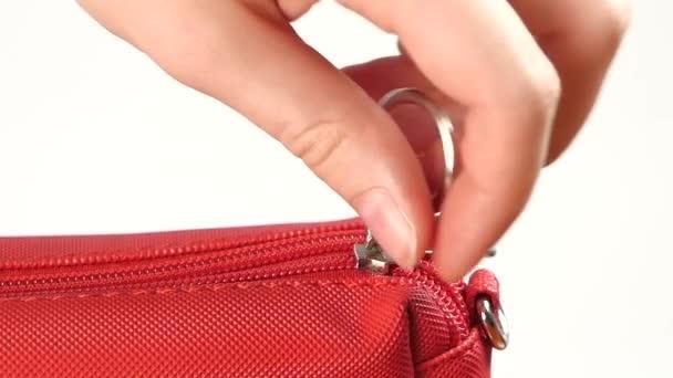 Unbutton red handbag, on white, slow motion