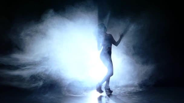 silhouette of pretty stripper naked woman. Slow motion. smoke