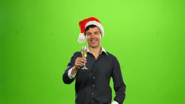 Happy smiling new years man with glass of champagne. green screen