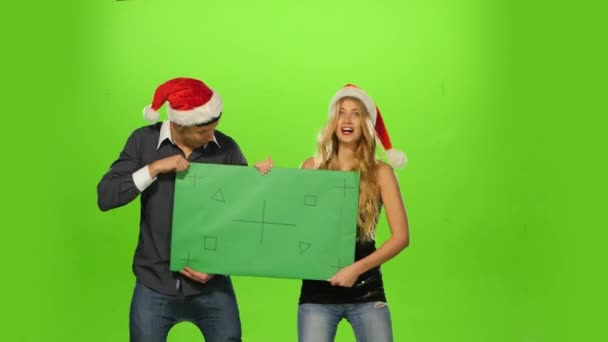 emotional man and woman: new year eve. green screen, blank sign