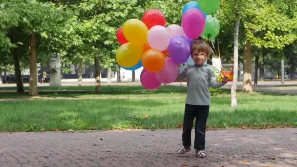 Little girl playing with balloons, Slow motion