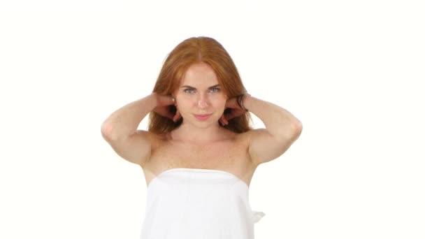 Beautiful girl throwing back her hair, bathroom
