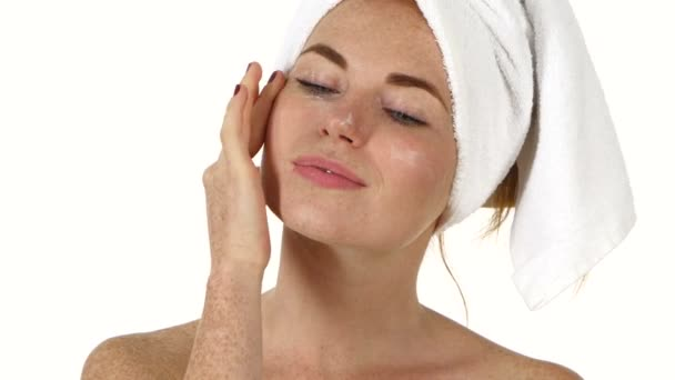 woman applying  cream on face. Close up, bathroom