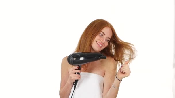 Redhead girl singing while blow-dry. Close up. slow motion, bathroom
