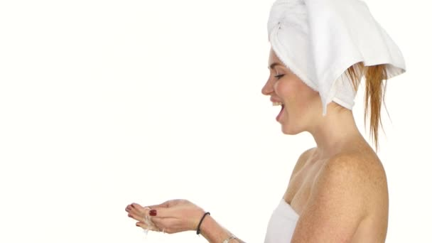 Young female washing her face with clear water, bathroom
