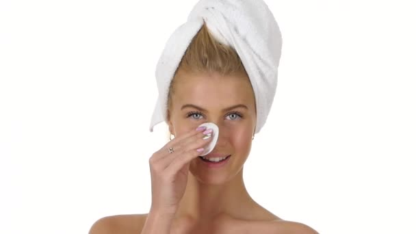 girl Making her face clean and fresh on white. Close up, slow motion