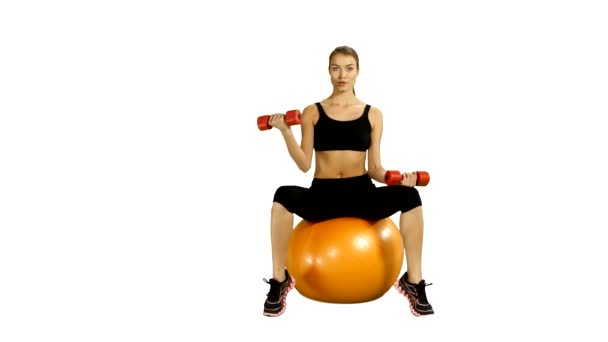 sport sitting on pilates ball and exercising with dumbbells. white background