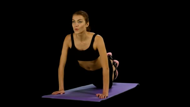 woman in a traditional yoga pose, stretching. Gym, alpha channel, matte