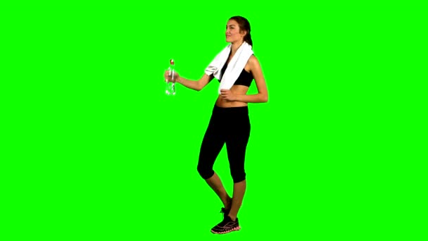 sporty muscular woman drinking water, Green screen