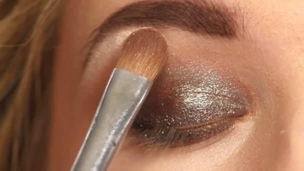 Makeup. Make-up. Eyeshadows. Eye shadow brush. Close up