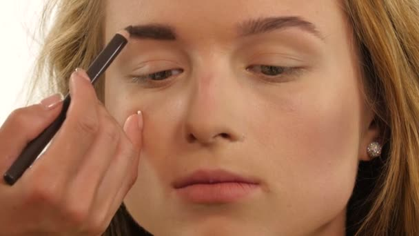 woman draw beauty shape of eyebrows using cosmetic brush, Close up