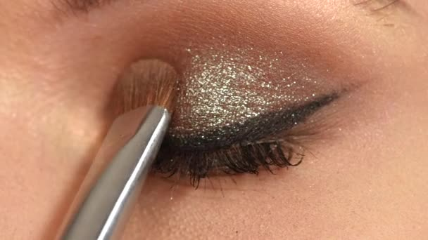 Beauty fashion. Eyelashes. Cosmetic Eyeshadow. close up. Slow motion