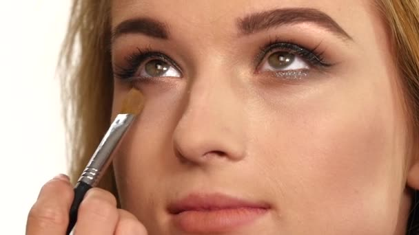 Beauty Girl with Makeup Brush. close up. Slow motion
