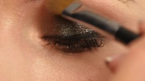 Girl with Makeup Brush. close up. Slow motion