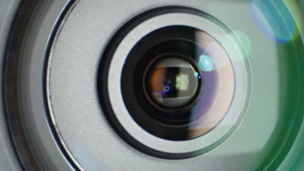 Glare on video camera lens, showing zoom, close up