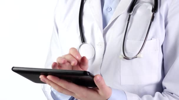 Doctor standing and holding tablet compute, wearing stethoscope, on white