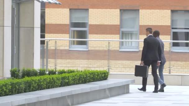 businessman walking on the street near office building
