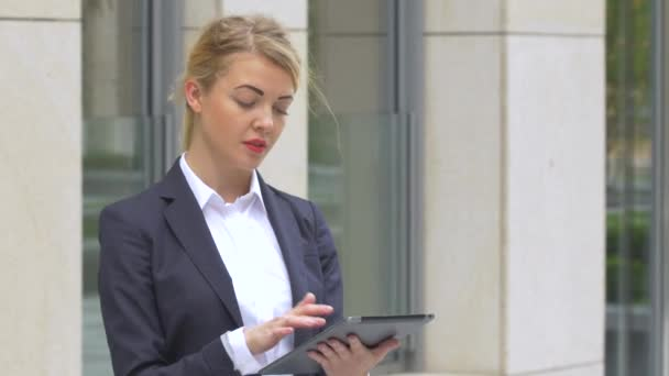 elegant business woman with tablet computer near office building. close up