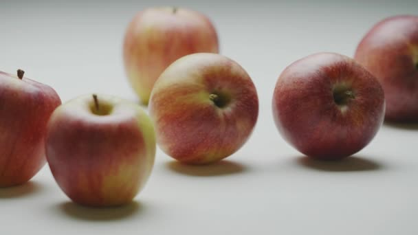 Apples hit, two organic natural moving fruits strike collide with each other, close up studio video
