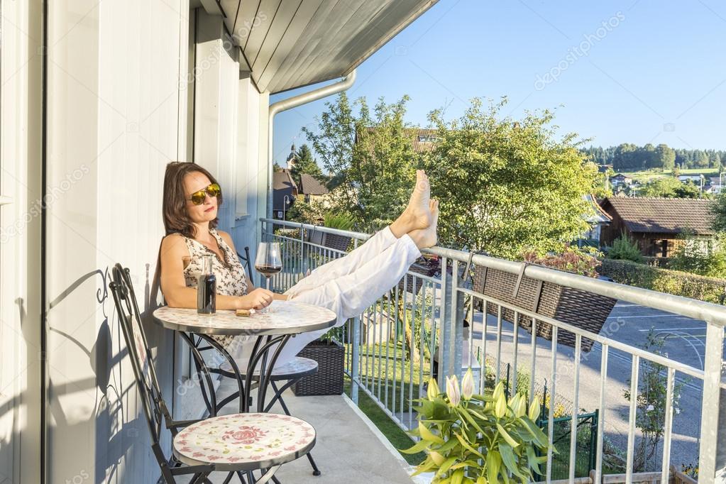 Cute Woman Drinking Wine On A Terrace Stock Photo