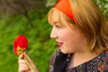 charming rosy-cheeked young woman dressed in Russian style with