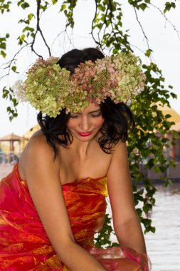 young Russian woman on her head a wreath of flowers hydrangeas,