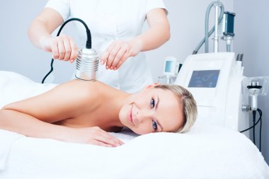 young woman getting cavitation procedure