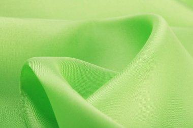 macro texture smooth satin fabric light green color studio