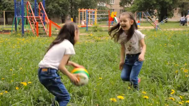 Kids play with ball outdoor