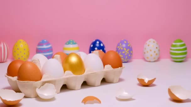 Colorful painted Easter eggs on the pink table. Eggs colored on a pink background.