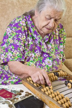 Pensioner counts money