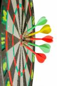 Darts arrows in the target center on a white background