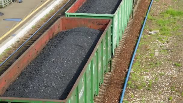Freight train with coal moving on train station