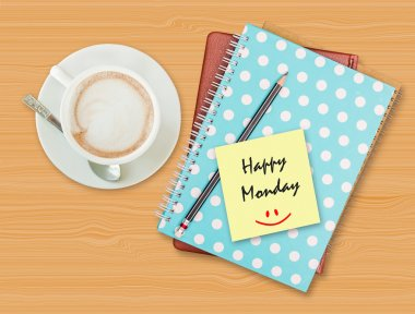 Happy Monday and smile on blank paper with coffee cup