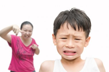 Boy being Scolded by his mother