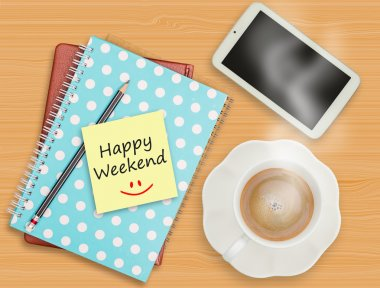 Happy Weekend and smile on blank paper with coffee cup