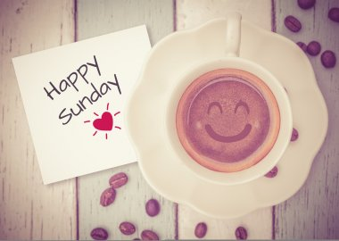 Happy Sunday with coffee cup on table